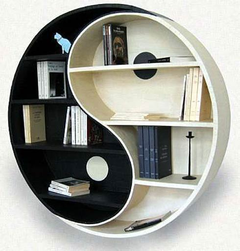 Yin and Yang round shelf unit hung on the wall, with one half white and one half black