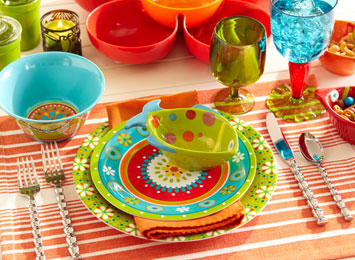 Bright and colourful table setting in orange, green and blue