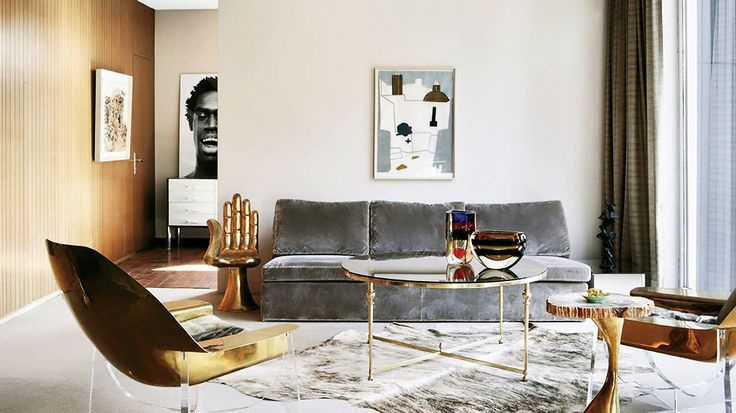 Dark grey plush sofa in white and gold living space