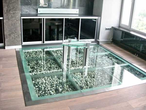 Glass floor framed with laminate wooden floor