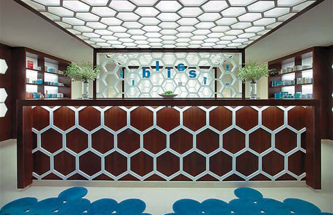 Honeycomb shapes and patterns in a bright room with dark wood shelves