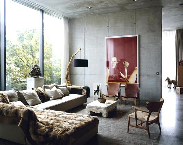 Industrial concrete living room with fur sofa throws