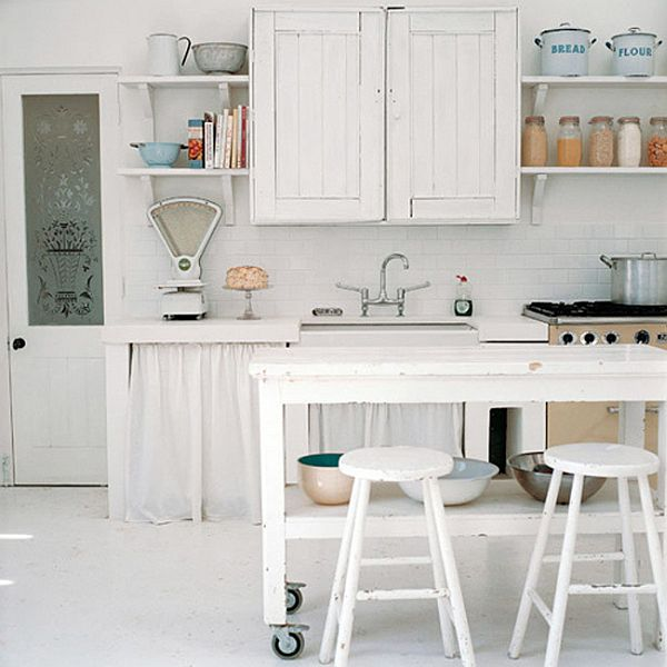 White Scandinavian style kitchen, with rustic unit doors and matching island and stools