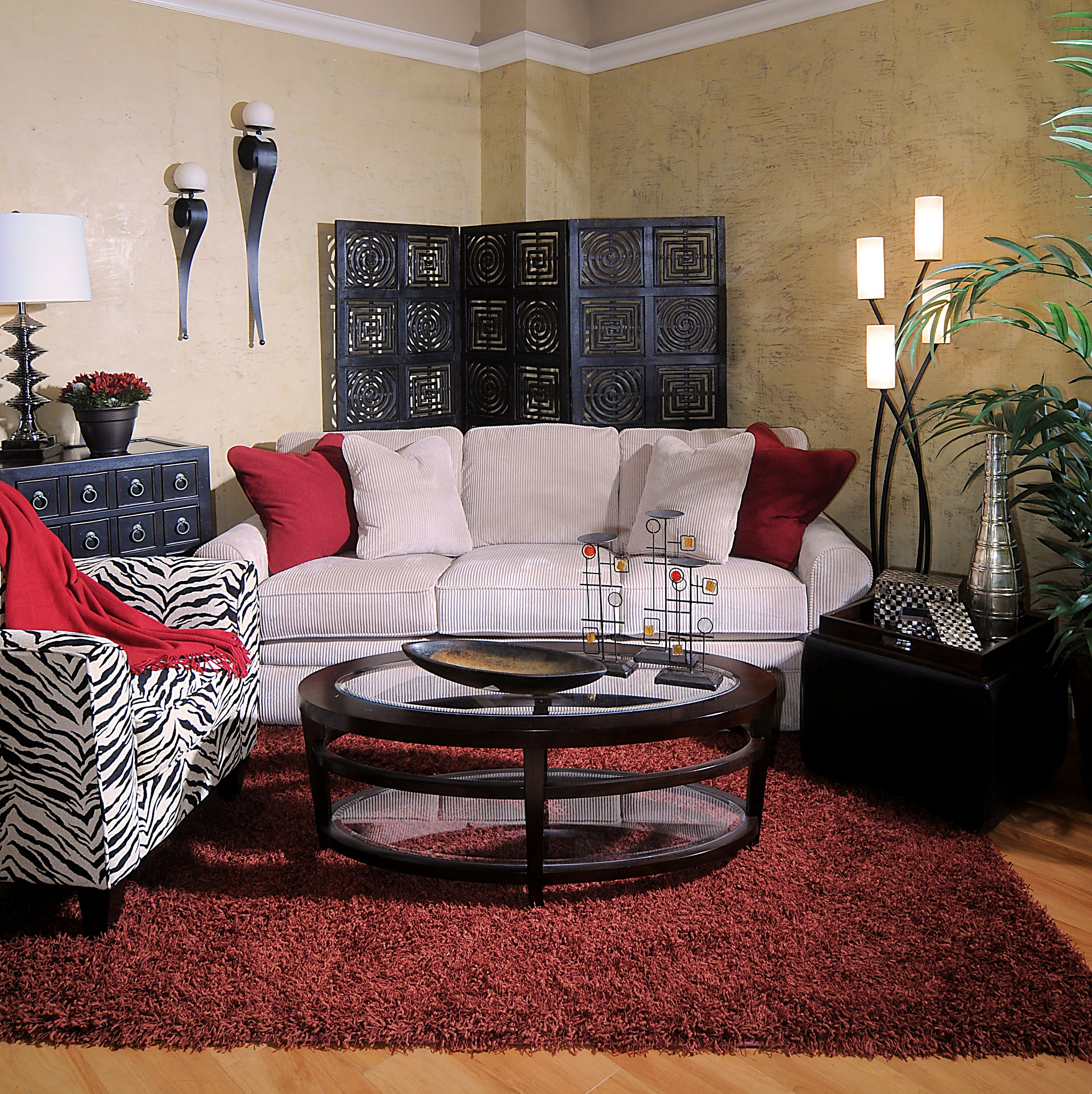 Cosy living room with an African-esque black and red design, with Zebra print armchair