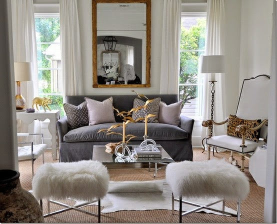 Cream living room with dark grey sofa and touches of gold throughout the room