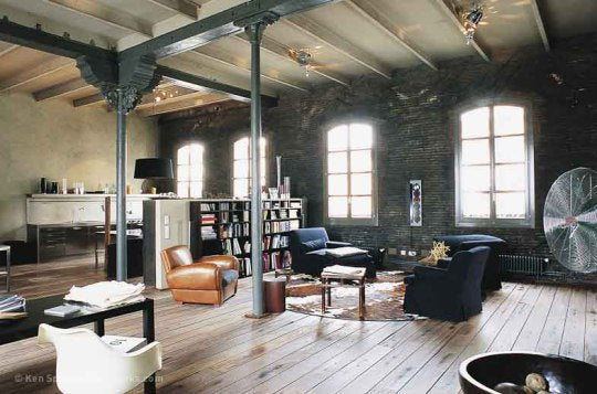 Industrial living room with seating area and exposed cream metal support beams