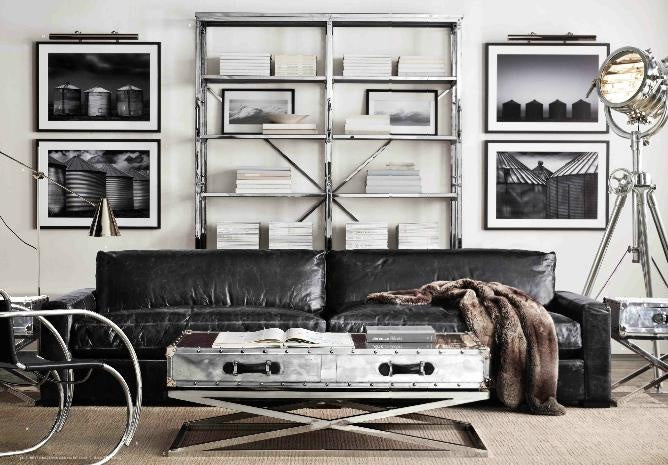 Stylish white and black living room with black leather sofa and black and white wall photographs