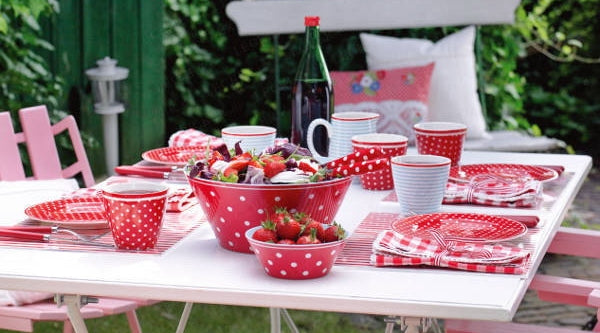 Picnic table setting with tasty strawberry fruit salad