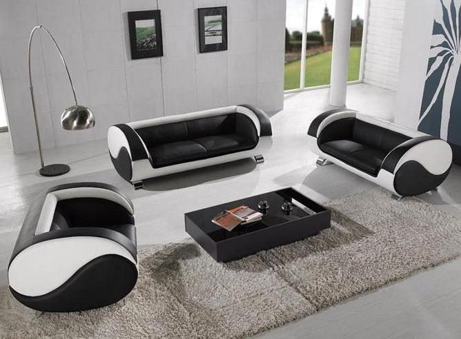 Black and white sofas and armchairs in white living room