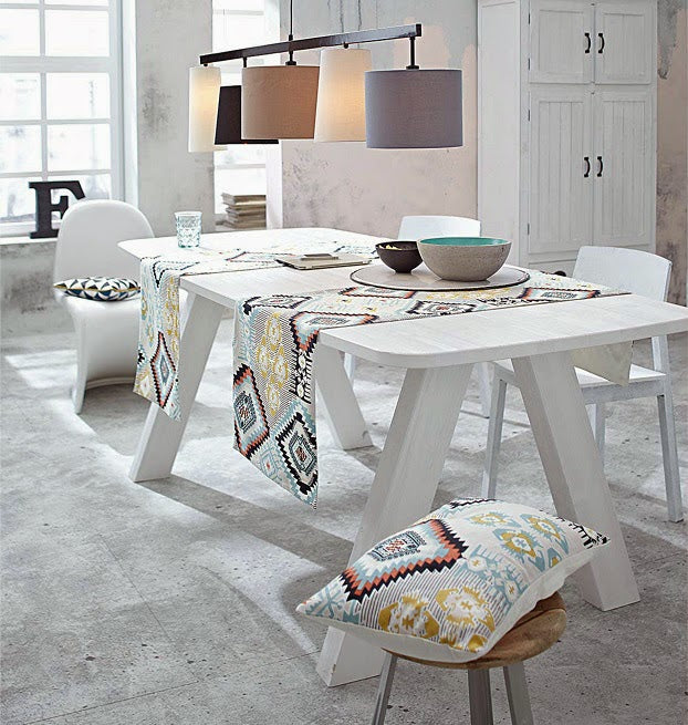 White wooden furniture in a concrete floor dining room