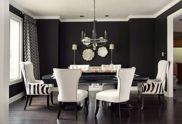 Black and white dining room with white chairs and black table