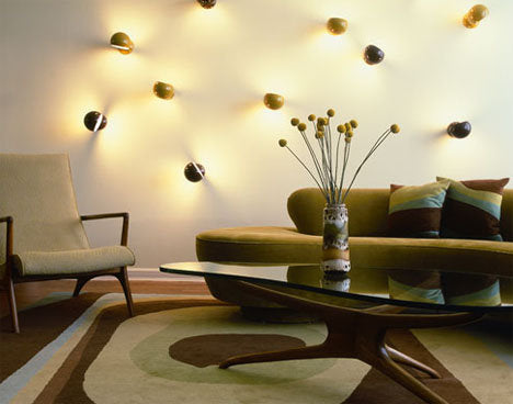 Lots of light heads covering a white wall in a classy living space