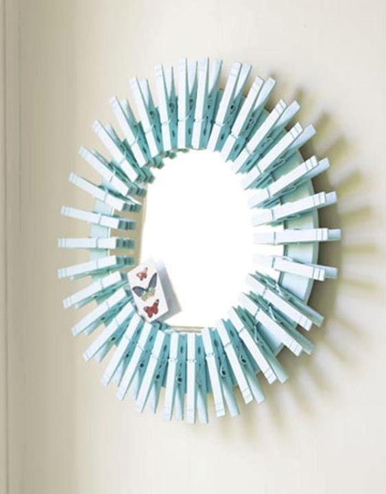 DIY mirror framed with clothes pegs
