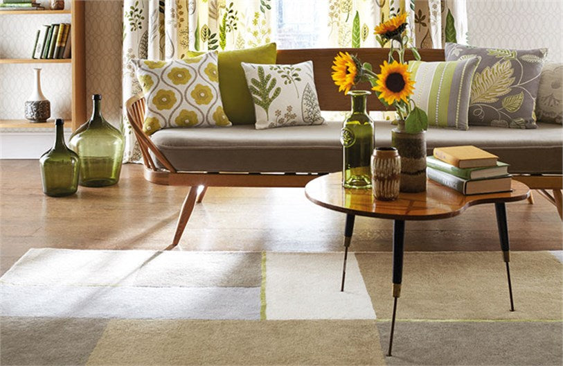 Harlequin rug in white, beige and grey under a sixties style sofa