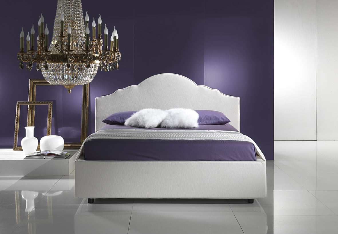 Bedroom with purple feature wall, purple bedding on a white bed and white mirror shine flooring and gold chandelier
