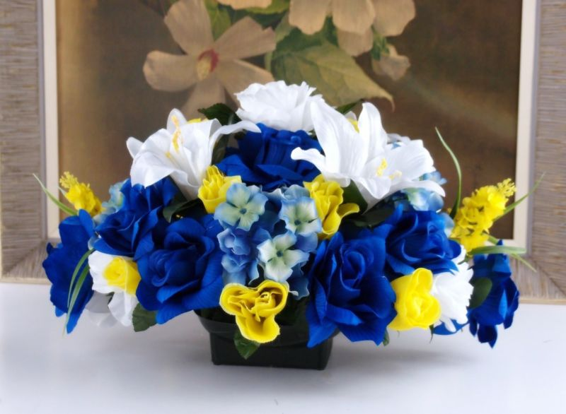 Floral display in blue, yellow and white