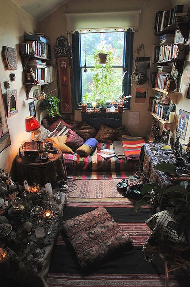 Cosy small reading corner with floor bed and cushions