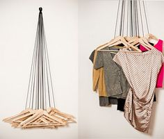 Coat hangers against the wall on individual pieces of string, rather than a typical clothes rail
