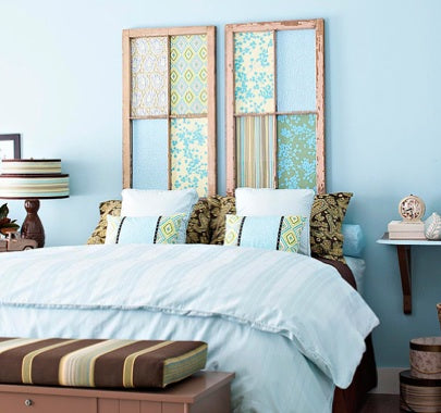 Very light blue bedroom with blue bedding and touches of brown and green