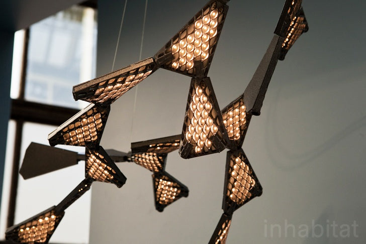 Digital modular LED lights, looks like a swarm of butterflies hanging from the ceiling