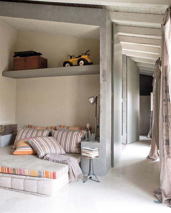Rustic design interior with contained bed in concrete alcove