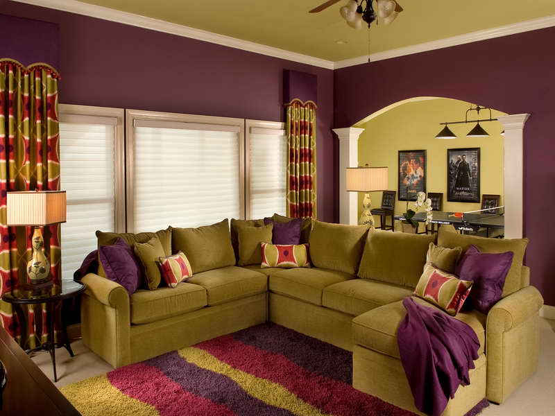 Purple and gold living room with C shaped sofa