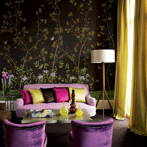 Exotic living room with brown wallpaper that shows a green intricate floral pattern, plus purple furniture
