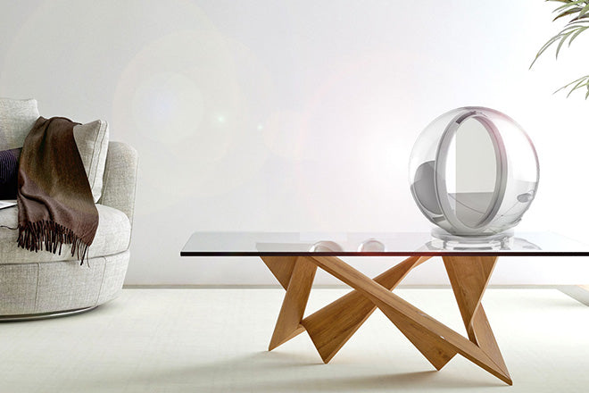 Glass table with funky wooden base and metal sun mirror