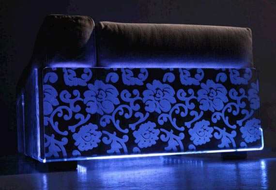 Funky black light sofa with floral pattern in blue