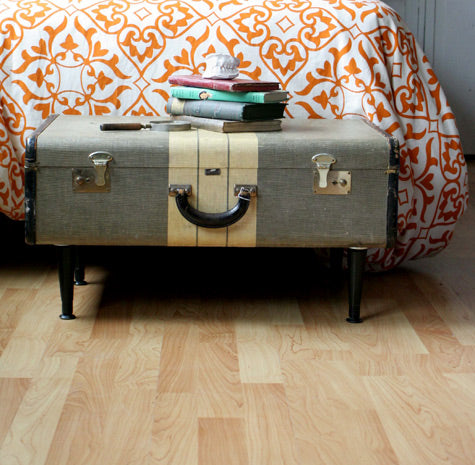 Old trunk suitcase converted into bed side table