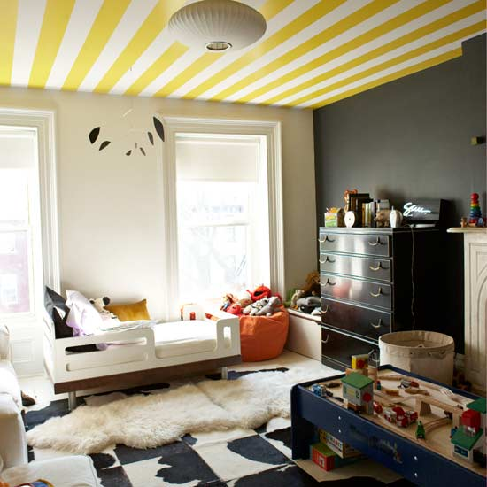 Yellow and white wallpaper on a ceiling, then grey and white walls