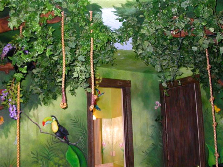 Green jungle kids bedroom with plastic foliage, ropes and toy toucan