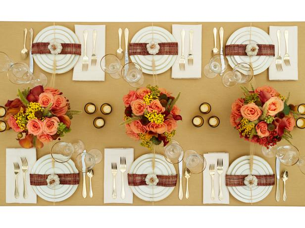 Gold Thanksgiving table setting with orange flower centre pieces
