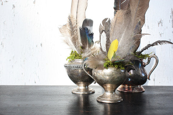 Feather centrepiece display in silver goblets