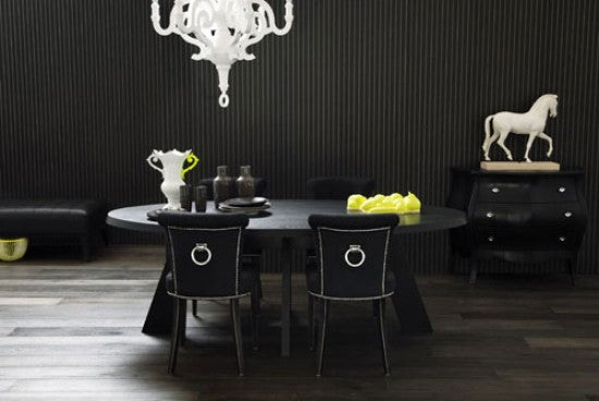 Black dining room with small black dining table