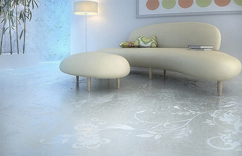 Concrete living room with pebbled shaped cream leather sofa