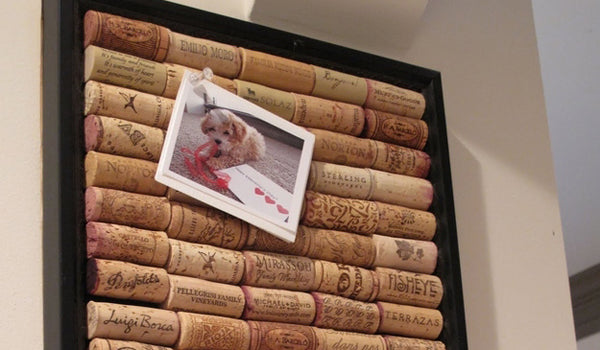 A board made from win bottle corks, with a picture of a dog pinned to it