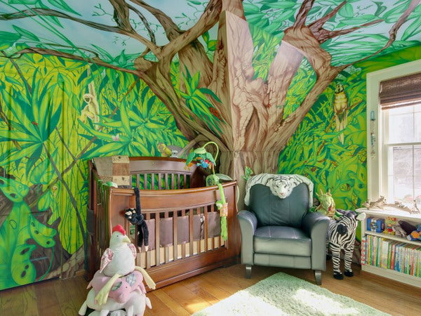 Jungle inspired kids bedroom with full wall tree painting