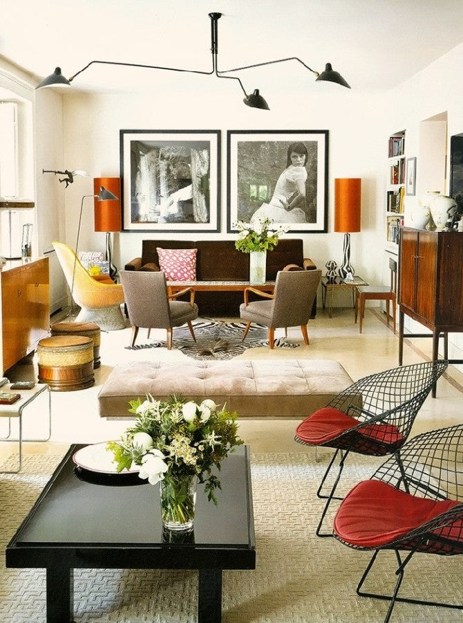 Cream living space with eclectic decor, hints of wood, creams, red, browns and beiges