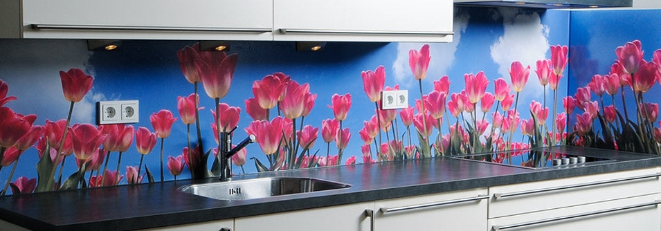 Kitchen counter top with mural splash back of pink flowers and a blue sky background