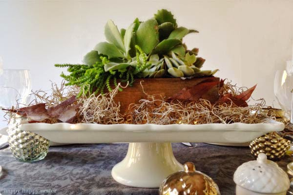 Ceramic plate centrepiece containing greenery and leaves