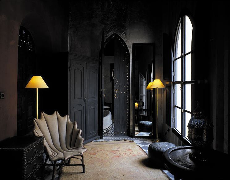 Gothic style black doors, furniture and accessories in a dark hallway