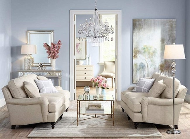 Stylish and traditional light blue living room, with cream sofas