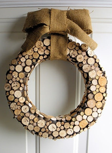 Wooden Christmas wreath made from sawn branches and twigs