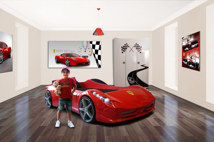 White bedroom with dark wooden flooring, red Ferrari race car bed and matching wall art canvases