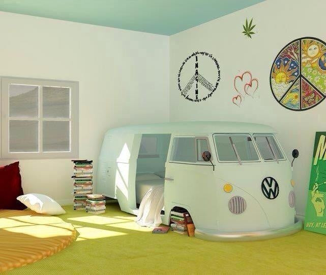 A mint green bed that looks like a VW camper van, in a white room with peace symbol and hearts on the wall