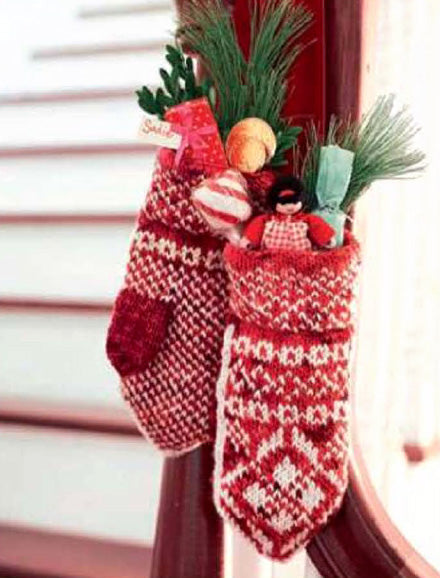 Red and white mittens used as Christmas stockings