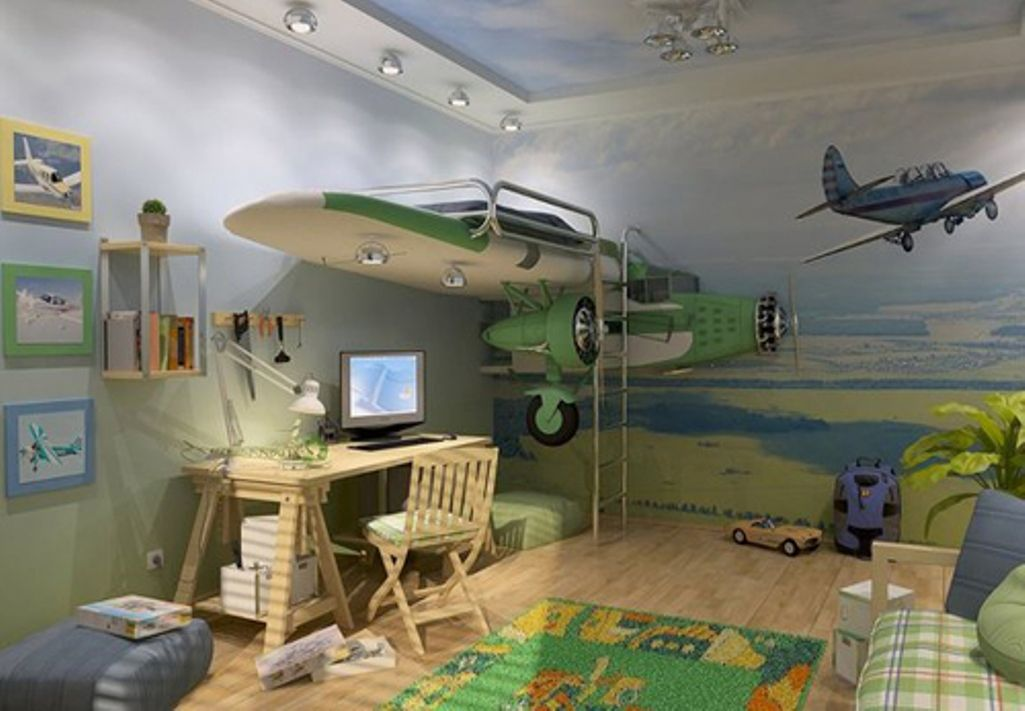 Cool aeroplane themed kids bedroom, with childs bed on one wing of the plane