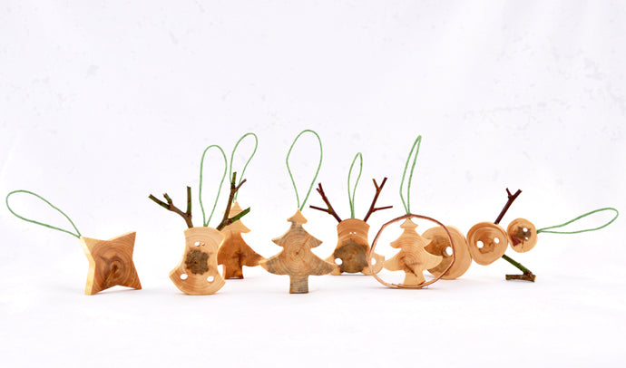 Tree decorations made from wood including star, reindeer and tree