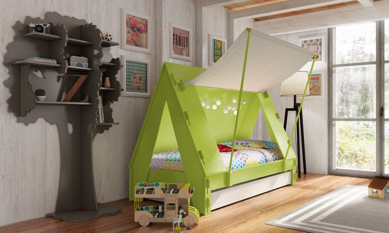 Wooden kids bed in green that looks like a tent, with a dark grey bookcase that looks like a tree
